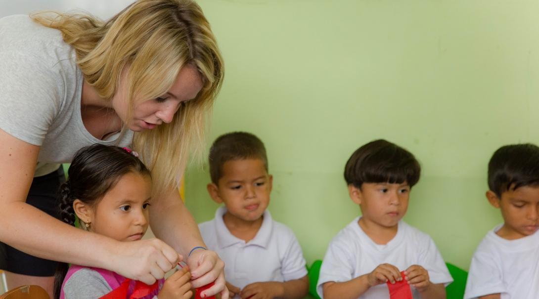 An intern works with a group of children during her Social Work internship in Ecuador